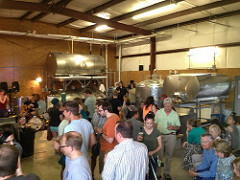 A large group of people waiting for beer at the brewery